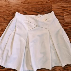 Formal white skirts with pockets
